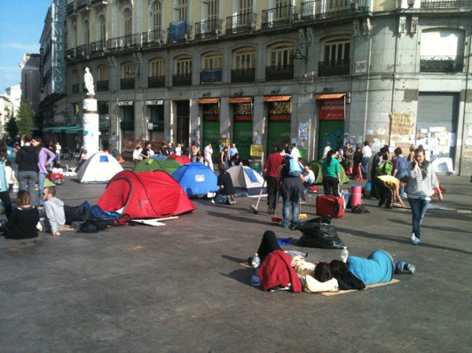 Spain votes as protesters camp out