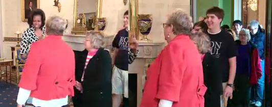 Michelle Obama greets a Ron Paul supporter during surprise White House tour