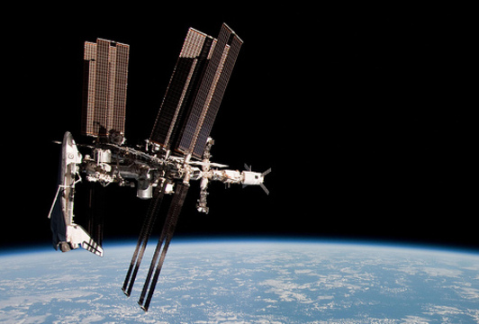 Space junk sends astronauts diving for cover