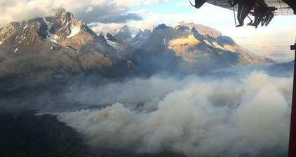 Chilean fire fighters battle blaze in Torres del Paine