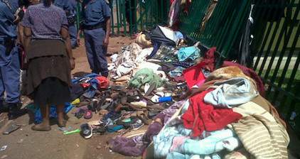 Woman dies in stampede for South African college place