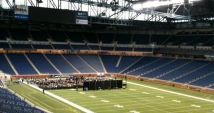Romney talks Cadillacs during stadium speech