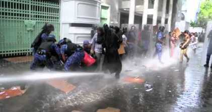 Maldives police disperse women's protest with water cannon