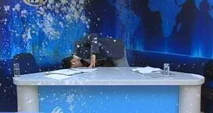 Greek news presenter pelted with eggs and yoghurt live on air