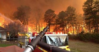 Wildfires rage across eastern US