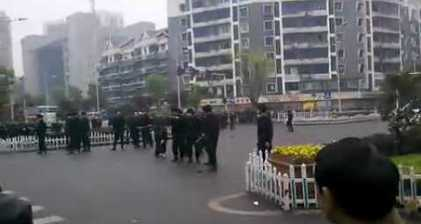 Chinese riot police quash thousands-strong rally