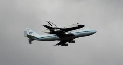 Eyes on the sky as space shuttle descends over the Big Apple